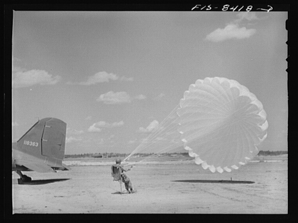 Rothstein, A., photographer. (1942) Fort Bragg, North Carolina. Parachutist in a military demonstration. Cumberland County Fort Bragg North Carolina United States, 1942. Sept. [Photograph] Retrieved from the Library of Congress, https://lccn.loc.gov/2017837271.