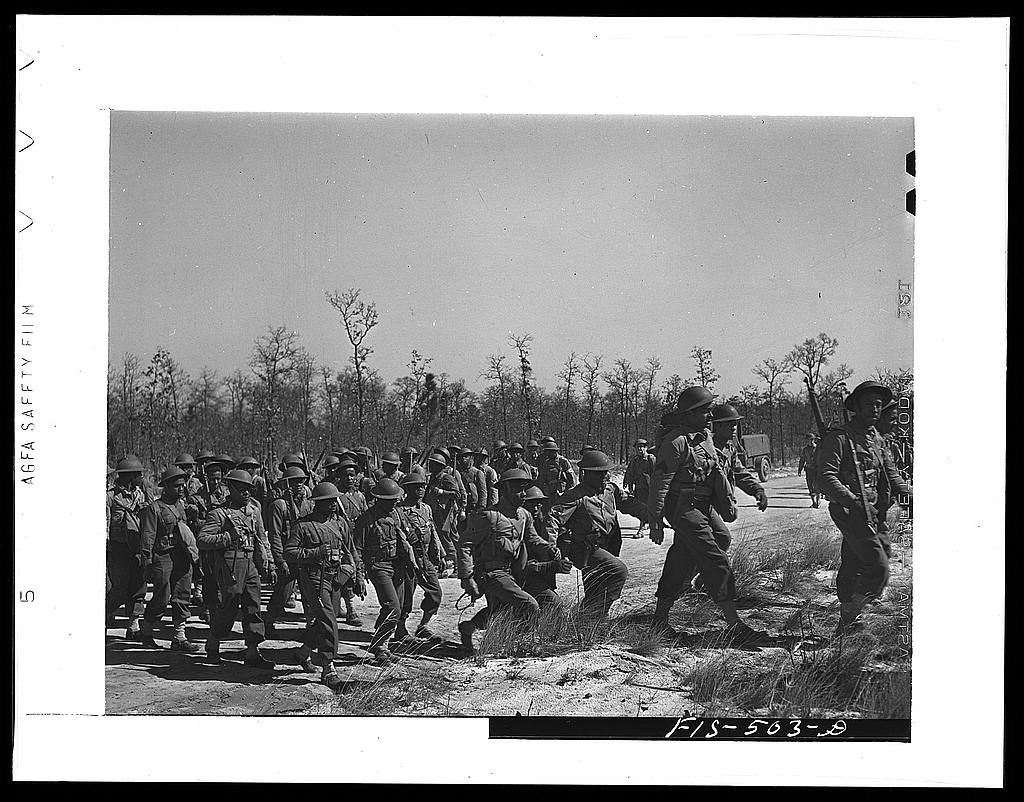 Rothstein, A., photographer. (1942) Fort Bragg, North Carolina. 41st Engineers on the march. Cumberland County Fort Bragg North Carolina, 1942. Mar. [Photograph] Retrieved from the Library of Congress, https://www.loc.gov/item/owi2001002792/PP/.