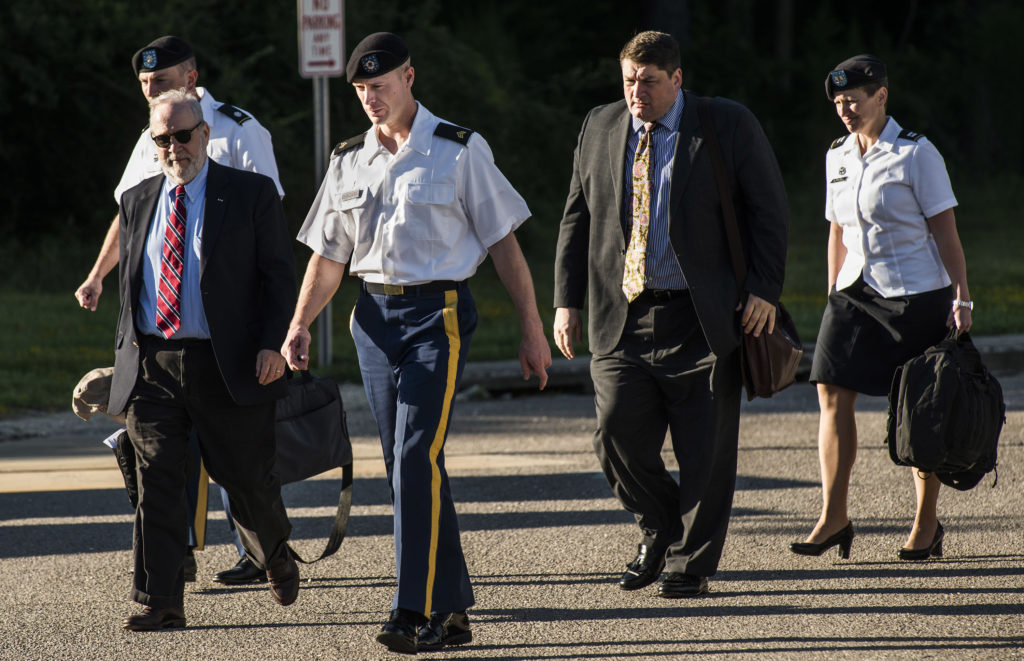 Sgt. Bowe Bergdahl, second from left, and some of his attorneys (lead counsel Eugene Fidell on left and assistant civilian defense counsel, Will M. Helixon second from right) arrive the courthouse Monday, Aug 22, 2016, at Fort Bragg, N.C. Attorneys for Bergdahl are scheduled to argue Tuesday that decision-makers with power over the soldier's prosecution were improperly swayed by negative comments from U.S. Sen. John McCain.<br /> (Raul R. Rubiera/The Fayetteville Observer via AP)