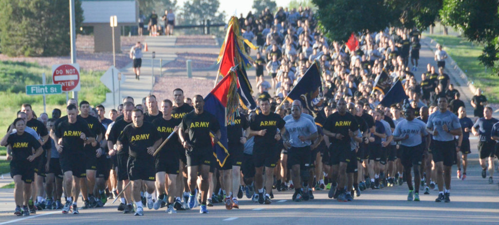 FORT CARSON, Colorado – More than 5,000 Soldiers from the 4th Infantry Division and Fort Carson mustered on Pershing Field today to kick-off Iron Horse Week 2016 during a 3.5-mile installation run led by commanding general, Maj. Gen. Ryan F. Gonsalves and Command Sgt. Maj. Michael A. Crosby, 4th Inf. Div. and Fort Carson. The run marked the beginning of Iron Horse Week, Aug. 1-4, a four-day celebration of the Iron Horse Division's history, camaraderie and esprit de corps. During the week of friendly competition and warrior events, Soldiers prove their mettle earning tournament to champion their units toward the overall objective of earning the Iron Horse Division Commander's Cup. Events include basketball, flag football, softball, ultimate Frisbee, combatives, combat swim, golf, marksmanship, medical stakes and orienteering. The week of fun concludes Thursday with unit barbecues and a USO-sponsored concert featuring contemporary country western performer, Josh Turner. (U.S. Army photos by Sgt. Benjamin Kullman, 4th Infantry Division Sustainment Brigade Public Affairs Office)