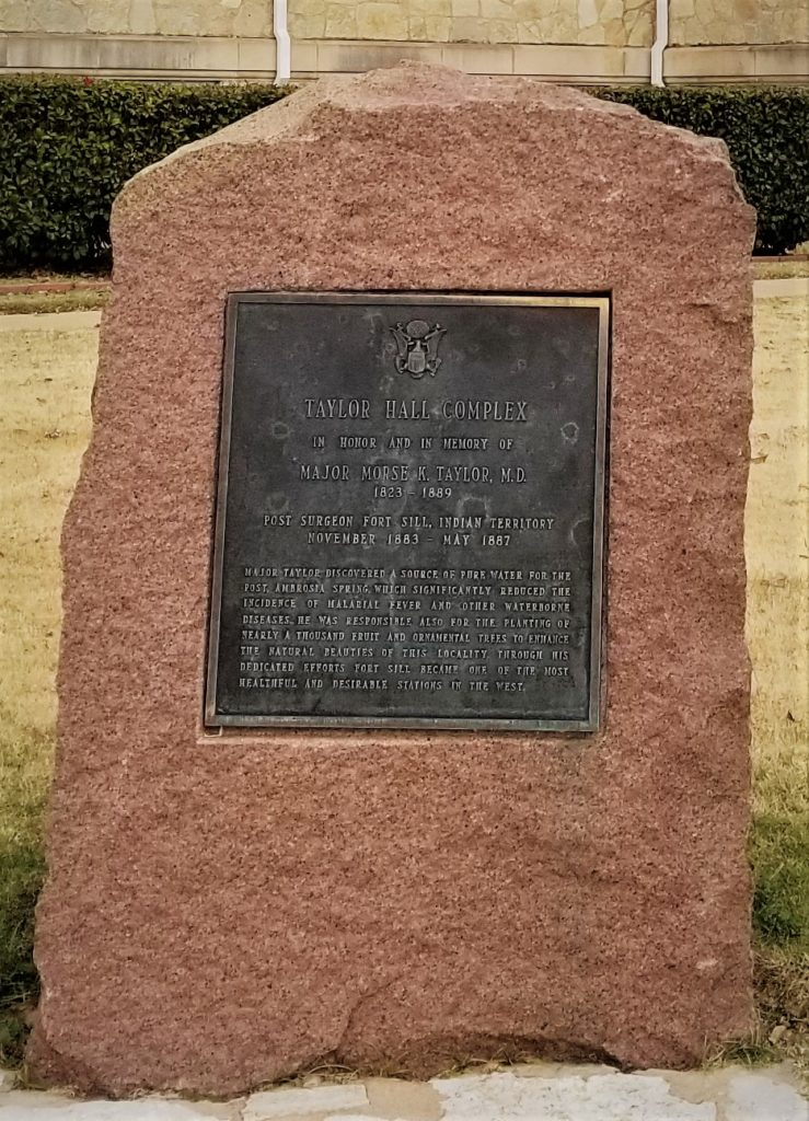 Monument in front of Taylor Hall (OSJA) in honor of Major Morse K. Taylor, M.D. (1823-1889). Major Taylor served as the Fort Sill Post Surgeon from 1883-1887, and discovered a source of fresh water for the post and planted nearly a thousand trees on post to beatify Fort Sill.